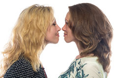 Two sisters looking at each other Royalty Free Stock Photos