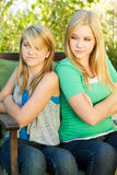 Sisters upset and fighting. Two sisters mad angry upset and fighting Stock Photos