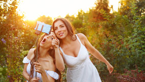 Two sisters make selfie Royalty Free Stock Photo