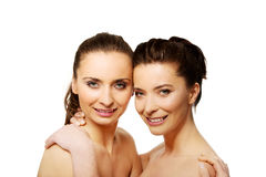 Two sisters with make up embracing. Stock Photography