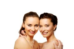 Two sisters with make up embracing. Royalty Free Stock Photos
