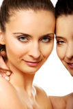 Two sisters with make up embracing. Stock Photo