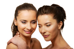 Two sisters with make up embracing. Royalty Free Stock Images