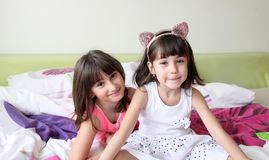 Two sisters. In morning bed royalty free stock photography