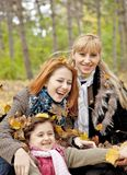 Two sisters and mother in the park. Royalty Free Stock Photos