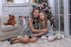 Free Two Sisters Near A Christmas Tree Stock Image - 28384131