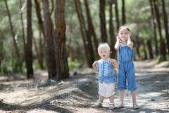 Two sisters outdoors at summer day Stock Photos
