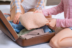Two sisters are packing baggage Royalty Free Stock Image