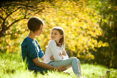 Two sisters in a park in autumn Royalty Free Stock Photos