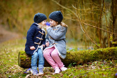 Two sisters picking the first flowers of spring Royalty Free Stock Images