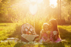 Two sisters at the picnic. stock images