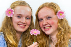 Two sisters with pink flowers in hair Royalty Free Stock Photos