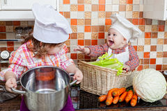 Two sisters play cooks Royalty Free Stock Images