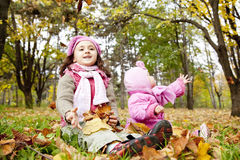 Two sisters play in the park. Outdoor shot Stock Photo