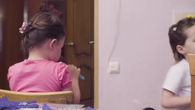 Two sisters playing in the kitchen stock footage