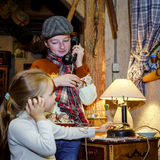 Two sisters playing with old vintage telephon Royalty Free Stock Image