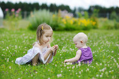Two sisters playing outside Royalty Free Stock Photography