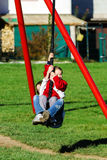 Two sisters playing in the playground, sunny day Stock Image