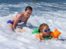 Two sisters playing in the sea, Nice Royalty Free Stock Photo