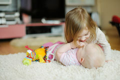 Two sisters playing together Stock Photography