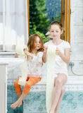 Two sisters playing with toilet paper roll Stock Photography