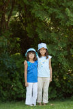 Two sisters. A portrait of two little girls with the backdrop of lavish greenery Royalty Free Stock Photos