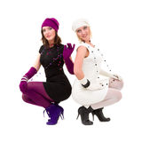 Two sisters in knit wool hat and mittens Royalty Free Stock Images