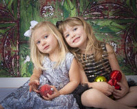 Two Sisters Posing for Christmas Pictures Stock Photos