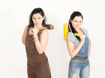 Two sisters posing while renovating Stock Photos