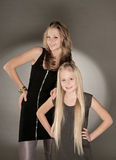 Two sisters posing in studio Royalty Free Stock Photo