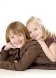 Two Sisters Posing - Vertical Royalty Free Stock Photos