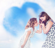 Two sisters posing. Royalty Free Stock Photography