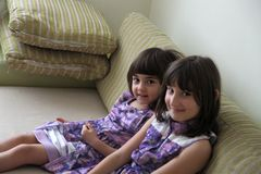 Two sisters. In purple dresses royalty free stock photos