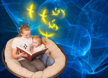 Two sisters reading book Royalty Free Stock Images