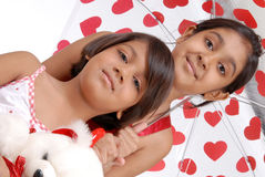 Two sisters in red and white theme Royalty Free Stock Image