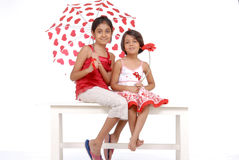 Two sisters in red and white theme Stock Image