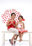 Two sisters in red and white theme Royalty Free Stock Photos