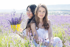 Two sisters are resting on the field of lavender Royalty Free Stock Photo
