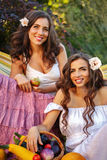 Two sisters and a rich crop Royalty Free Stock Photos