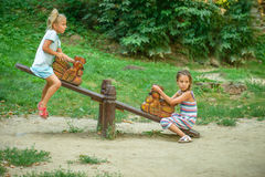 Two sisters ride on swings Royalty Free Stock Photography