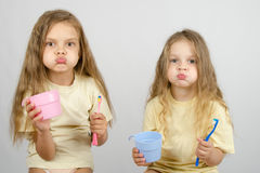 Two sisters Rinse your mouth brush your teeth Stock Images