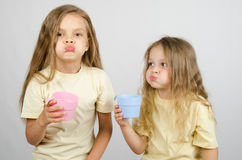 Two sisters rinse your mouth after brushing your teeth Stock Image