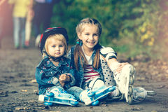 Two sisters on roller skates Royalty Free Stock Image