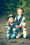Two sisters on roller skates Royalty Free Stock Photo