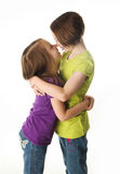 Two sisters showing love Royalty Free Stock Photography
