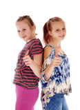 Two sisters showing thump up. Royalty Free Stock Image