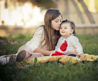 Two sisters sitting Stock Photography