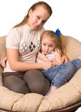 Two sisters sitting together Royalty Free Stock Images