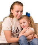 Two sisters sitting together Stock Images