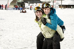 Two sisters in ski suits Stock Image
